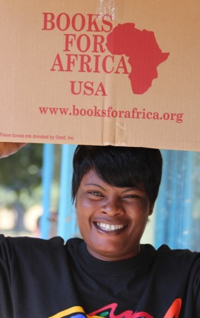 Mama Kawatu unloads books for Chilena Library